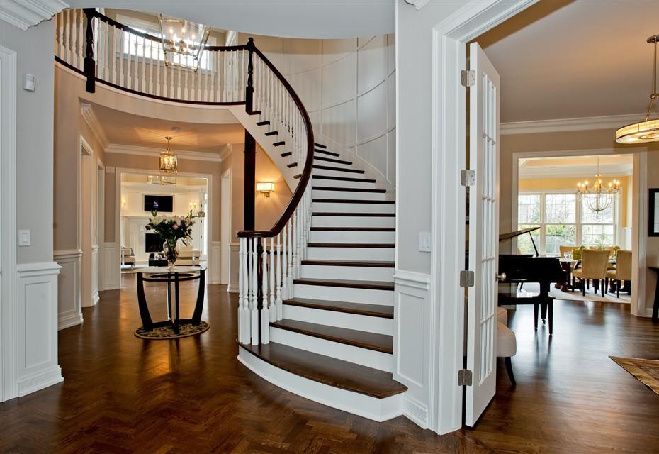 desain rumah mewah dengan foyer tangga setengah lingkaran